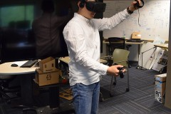 Arm fatigue accumulates during a prolonged use of mid-air interfaces such as Oculus Rift. (Purdue University Photo/Brian Huchel)