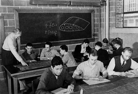 Professor Bruhn and students (note slide rules).