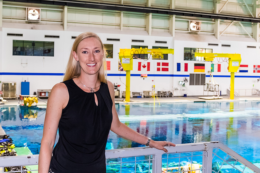 Allison Bolinger at the Neutral Buoyancy Lab, the largest swimming pool in the world, where future astronauts train for spacewalks. (Photo by Trevor Mahlmann)