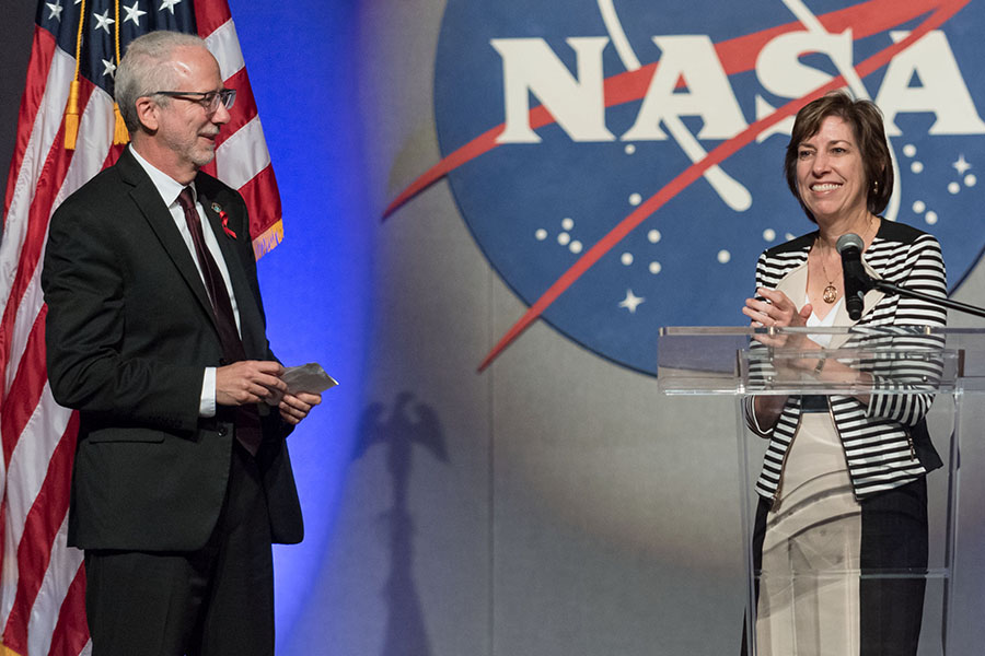 Outgoing NASA Johnson Space Center Director Ellen Ochoa introduces incoming director Mark Geyer as the next director at an employee all hands meeting on May 14, 2018, in Houston. Photo credit: NASA (Photo courtesy of NASA)