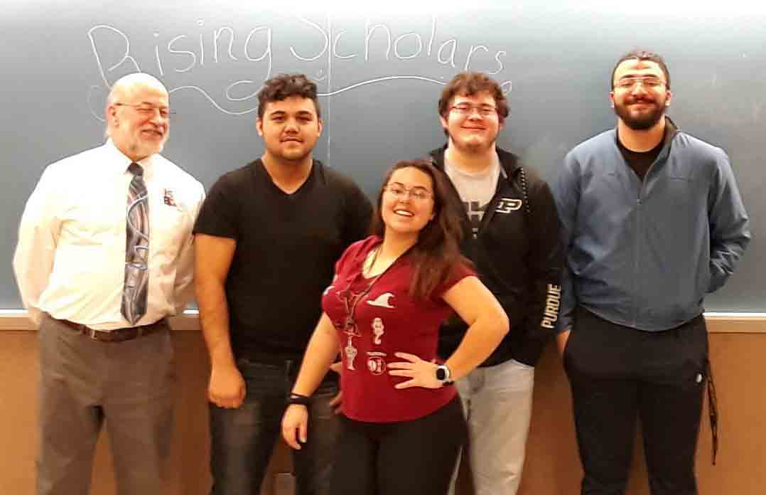 Javier Flores, Nicole Huddleston, Marco Baez, and Richardo Gonzalez celebrate the end of their fall 2018 Rising Schoplar seminar course with Dr. Bob.