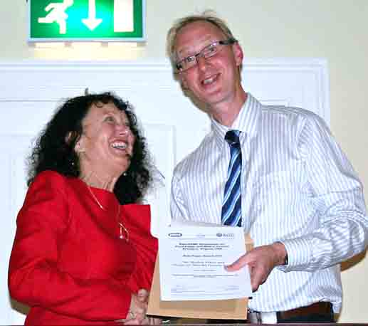 Professor Ivantysynova receives the Best Paper Award from Andrew Plummer