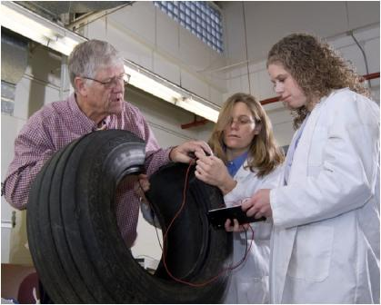 Dr. Krutz and grad students examining the tire with sensors