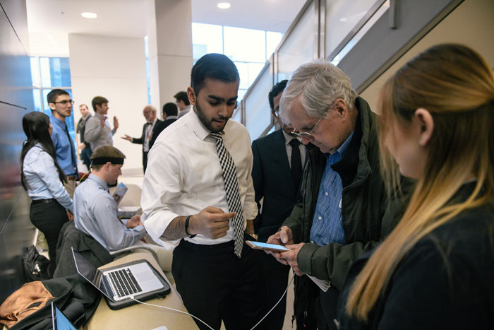 Students explain senior design project to visitor