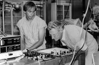 A graduate student and Leslie A. Geddes in the lab
