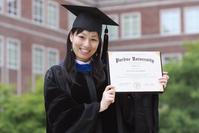 Feng Lin, holding her diploma