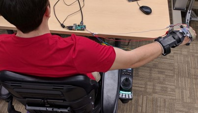 Man in wheelchair displaying wrist technology