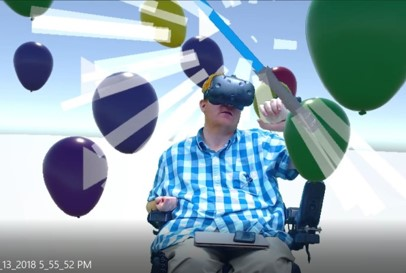 Man in wheelchair experiencing VR