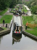 Students navigate the narrow boats through a set of staircase locks
