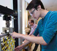 Gordon Jarrold tests chiral PXCM designs as lab manager David Restrepo looks on.