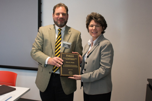 Rick Zadoks presents award to Dr. Mary Pilotte