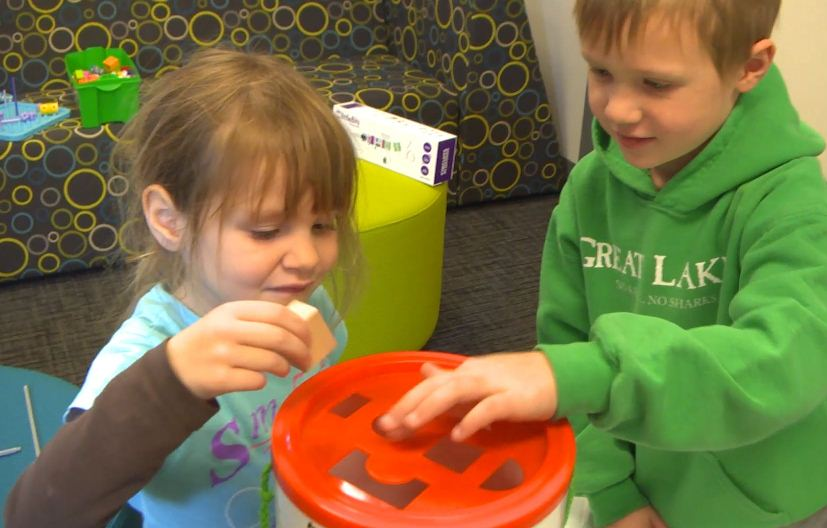 Children playing with engineering-themed toy