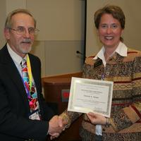 Michele Strutz receiving award