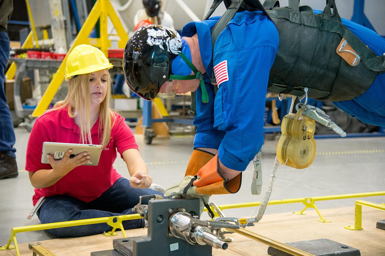 Allissa trains astronauts on procedures they will undertake during spacewalks.