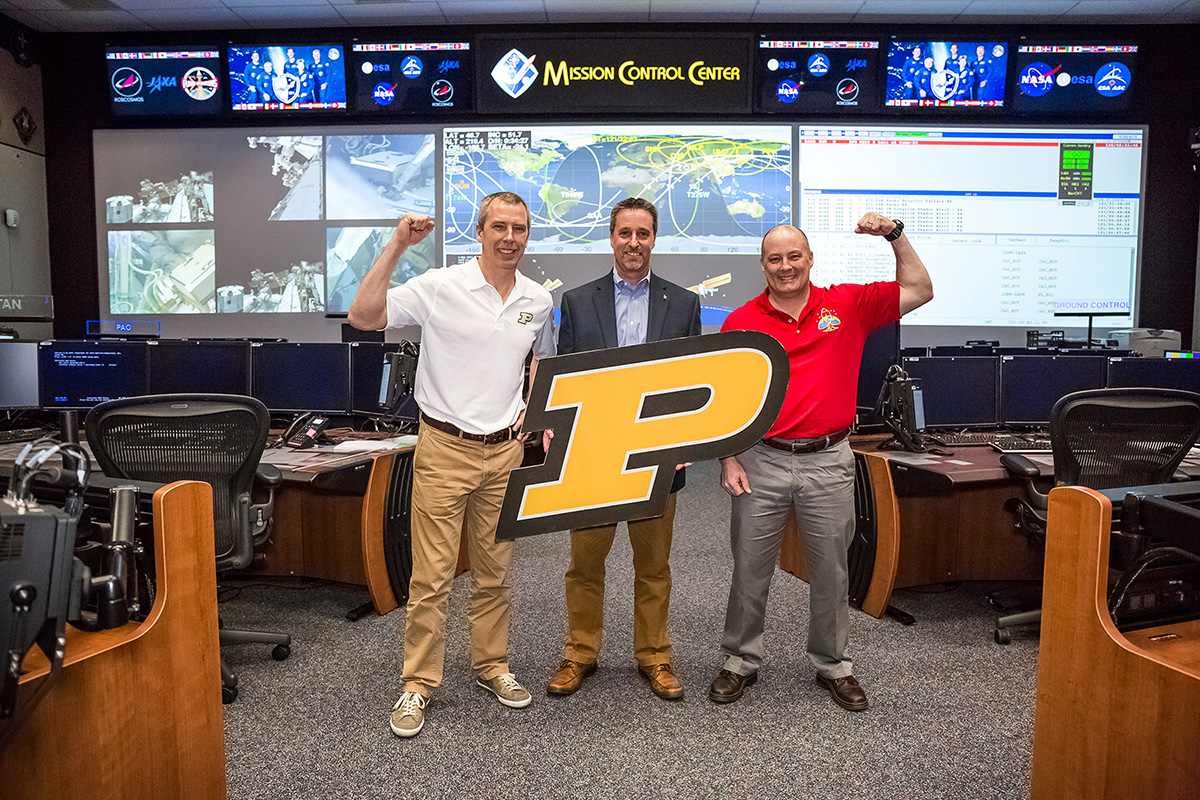 NASA is teaming with Purdue graduates. Astronaut Drew Feustel (left) will join Scott on the International Space Station in March 2018, and Gary Horlacher (middle) will serve as Flight Director.