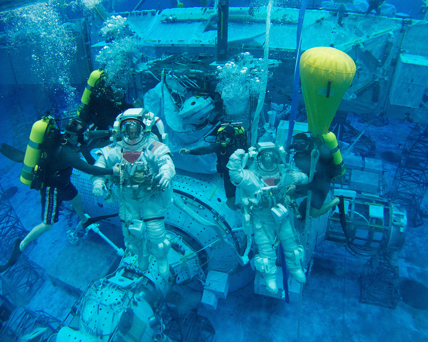 Scott Tingle (right) training with fellow astronaut Steve Swanson at NASA's Neutral Buoyancy Lab, the largest swimming pool in the world. <br>Photo Credit: NASA