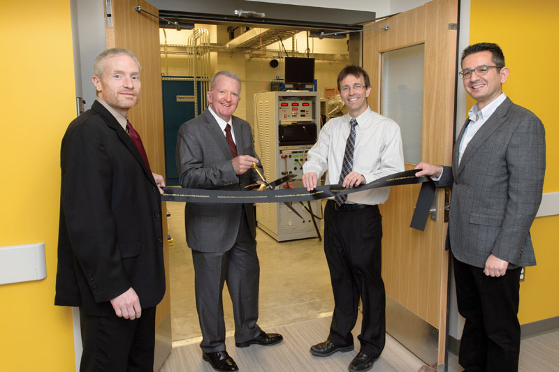 Faculty in the Power and Energy Systems group helped cut the ribbon on the Grainger Lab facilities during a two-day celebration in April. (From left) Scott Sudhoff, the Michael and Katherine Birck Professor of Electrical and Computer Engineering; retired Adm. William Hayden of The Grainger Foundation; Steve Pekarek, professor of electrical and computer engineering; and Dionysios Aliprantis, associate professor of electrical and computer engineering.