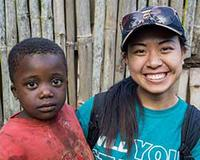 Cameroonian child with Pamela Yuan.