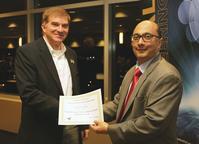 IE Head Abhi Deshmukh presents Associate Professor Steve Landry with the James H. Greene Outstanding Graduate Educator Award