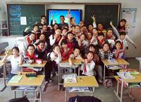 Scott Wong and Rafael Salcedo teaching English to a class of Chinese 4th graders