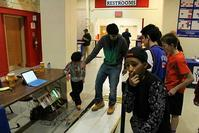 Students test the Power Pad which generates 10 watts of power for every step.