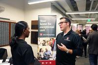 Photo of IE Career Fair - IU Health rep with student