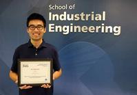 Photo of Tian Zhou & certificate