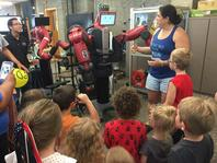 Photo of Maru Cabrera, robot and students