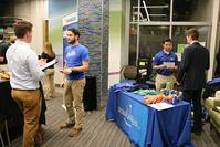Photo of students talking with Pepsico reps