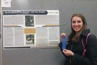 Photo of Lily Bishop & winning poster</em>