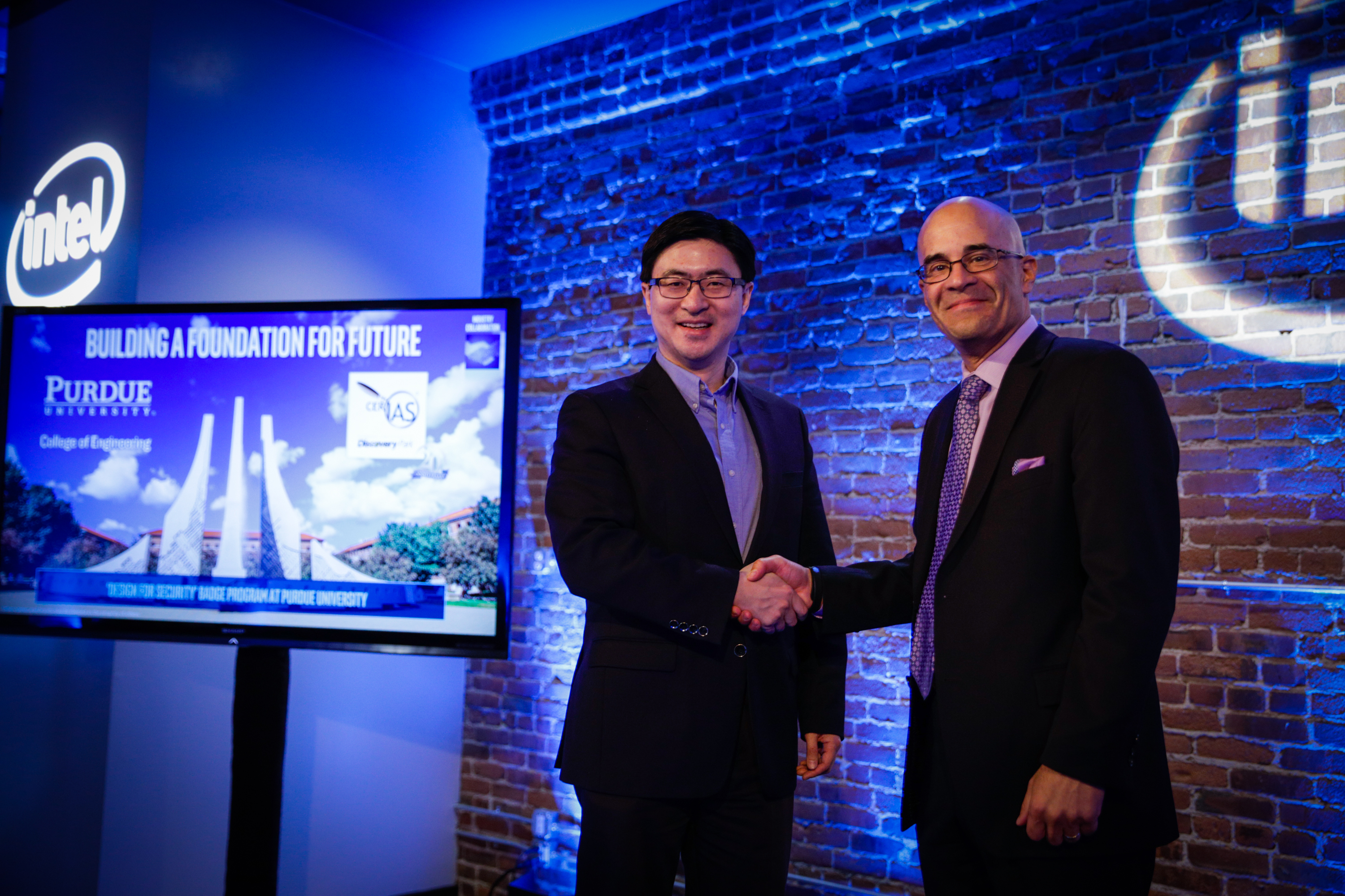 Photo of Purdue Engineering Dean Mung Chiang and Intel's Rick Echevarria