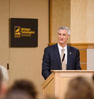Photo of Richard J. Koubek at podium