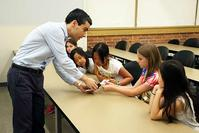 Photo of Ramses Martinez teaching elementary students