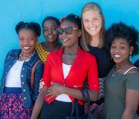 Photo of Lauren Neder with Haitian girls