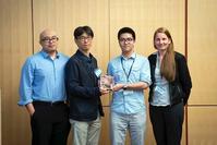 Photo of Gaojian Huang receiving CCAT award