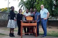 Photo of KMC furniture project collaborators in Malawi