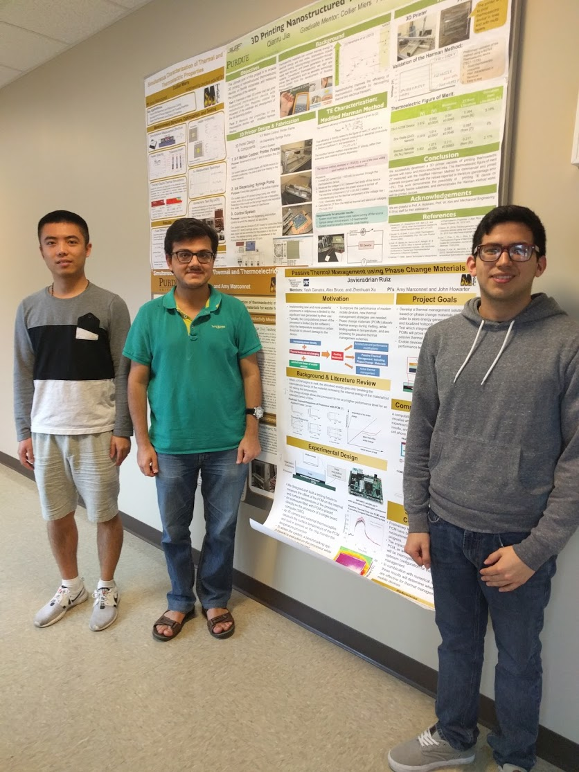 Adrian (right) with graduate mentors Yash (center) and Zhenhuan (left)