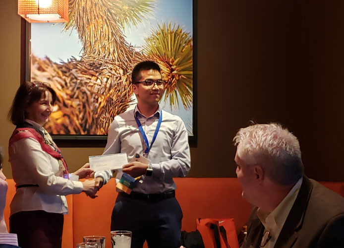 photo of Gaojian getting the award