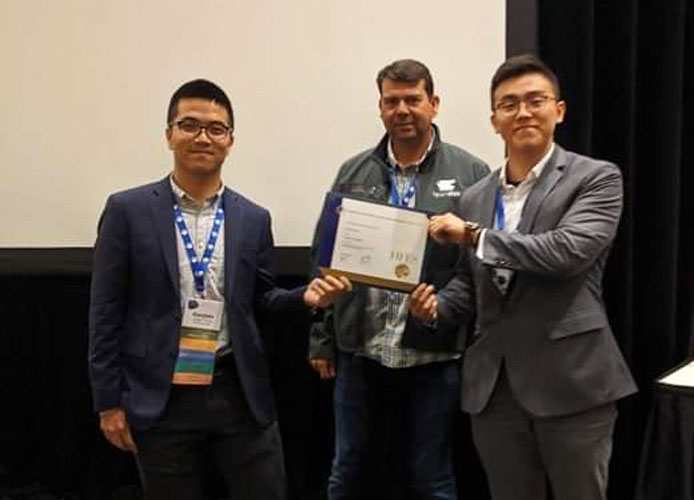 photo of receiving HFES gold chapter award