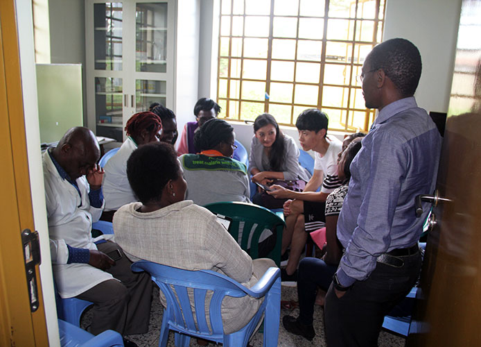 Photo of Yuehwern Yih & Dawei Wang teaching Ugandans