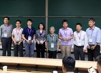 Photo of Hua Cai receiving CSIE 2018 Best Paper Award